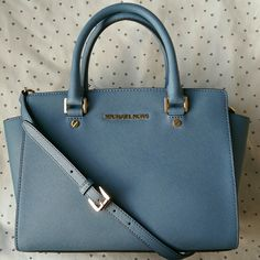"""Selma Saffiano Satchel This gorgeous winter blue satchel features 100% leather, top handles that drop about 4.75"""", adjustable straps that measures about 17.5""""-19.5"""", interior zipper and open pockets, 100% polyester lining and top zip closure. Brand new with tags. The bottom hardware of the bag does have tiny scuffs, probably from the retail counters, but perfect every where else. Got this as a gift but I already have one. Michael Kors Bags Satchels"""