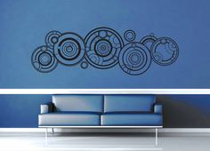 Doctor's name  https://geekerymade.com/collections/doctor-who-decals/products/doctors-name-gallifreyan-doctor-who-quote-wall-decal