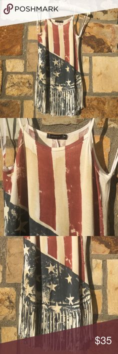 """ANTIQUE AMERICAN FLAG PRINT FRINGE BOTTOM TANK TOP ❌⭕️❌⭕️ Love this Spirit. color is like my pic not the stock photos. Super Cute. Brand New with Tags. 95% RAYON 5% SPANDEX // MADE IN USA Med measured laying flat is 14"""" armpit to armpit. Material stretches. I'm a 34"""" bust and 29.5"""" waist and a medium fits me perfect! TParty Clothing Tops Tank Tops"""