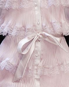 Delicate and beautiful. That soft pink and those sweet pleats with lace. TG
