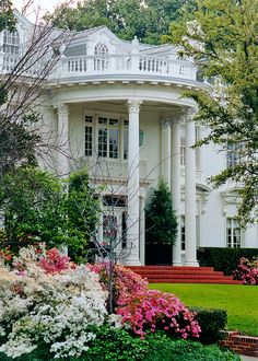 Beautiful portico on this Texas mansion--interesting that it used to be pink rather than white.