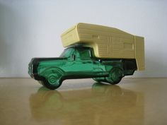 Vintage Avon bottle. Truck with Camper. After Shave and Talc containers. Tan…