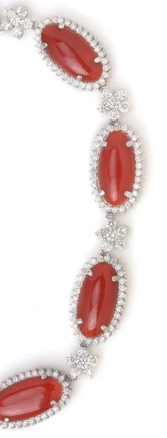 Distinctive Coral & White Diamond Necklace! See more gemstone jewelry on Gem Shopping Network! Item #493-13817  Coral Oval & 8.18 ctw Diamond Round 18K White Gold Necklace Length 18