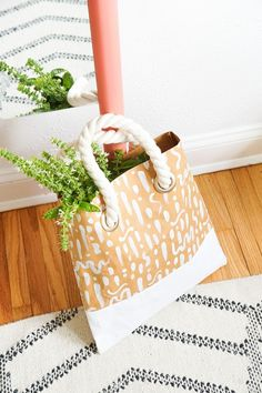 This DIY Pattern Paper Leather Tote let's you have the luxury look of a leather tote without all the hassle. See all the details in today's post...