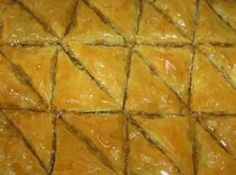 Baklava. Ingredients: 1 pkg phylo dough; 1 lb chopped walnuts or pistachios; 2 tsp cinnamon; 1 c butter melted; 1 c water; 1 c sugar; 1/2 c honey; 1 tsp fresh lemon juice; 1 Tbsp rose or orange blossom water (optional).  Follow link for instructions on how to make this indulgent delight!