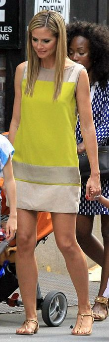 Who made  Heidi Klum's yellow and tan dress that she wore in New York?