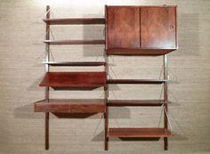 http://cgi.ebay.fr/ETAGERE-MODULABLE-PALISSANDRE-SCANDINAVE-ANNEES-60-/110722874911?pt=FR_JG_Art_Meubles_Rangements&hash=item19c798fe1f