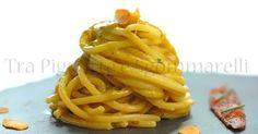 Tra Pignatte e Sgommarelli: Le mie ricette - Spaghetti con crema di fiori di zucchina, alici, erba cipollina e mandorle tostate piccanti