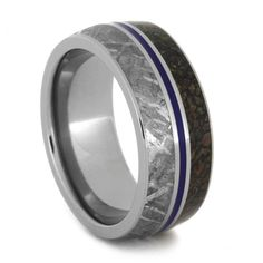 The materials used in this Titanium ring is rare and unusual. Meteorite, Dinosaur Bone and Blue Enamel inlays on a Titanium Band. From the Morrison Forma...