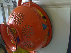LOVE this old red enamelware collander!