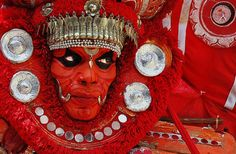 Scary face even without the makeup I think!  national geographic | Kuttikkol Thampuratty Theyyam