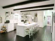 Fake ceiling rafters are a great way to add country character. Blogger Traci of Beneath My Heart used artificial beams to dress up her kitchen and hide a unsightly pipe in her bathroom.  Get the tutorial at Beneath My Heart.