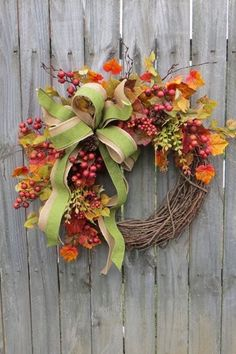 This festive autumn wreath has it all: color, texture and serious height. The faux green silk ribbon has a wire lining, which means your bow will never be out of place. BUY NOW: $79, etsy.com