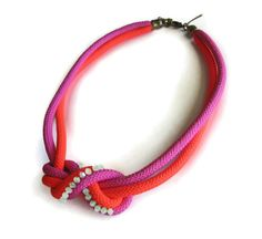 Neon rope necklace knotted with crystals in fucshia by maslinda, $67.00