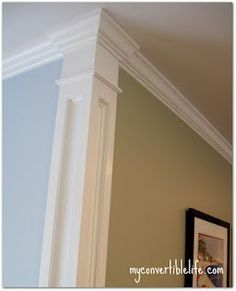 Oooh!! Great Idea!!! Separate rooms & wall colors by adding trim to the corners.