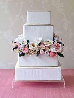 Cake Apothecary square crepe box cake with pink white and gold flowers on center layers