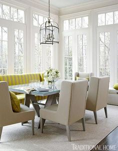Windows wrap this breakfast room in bright light, while the calm palette keeps things clean and crisp