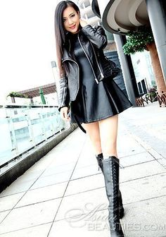 Flared black leather minidress, leather jacket, front laced OTK boots outfit
