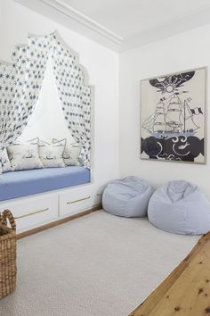Awesome boy's room boasts a Moorish style bed nook filled with a daybed with drawers adorned with brass pulls lined with nautical ship pillows in Katie Ridder Beetlecat Fabric finished with blue star curtains. Bed Nook, Cozy Nook, Daybed With Drawers, Built In Bed, Space Interiors, Beach Design, Nautical Design, Bed Styling, Kid Spaces