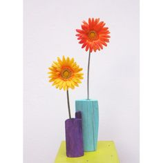 Make vase with driftwood by drilling hole. For faux flower, or make hole large enough to insert glass tube.