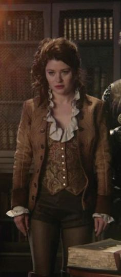 Belle, Once Upon a Time. I love how they had her evoking Rumpelstiltskin's s style a bit in this episode.