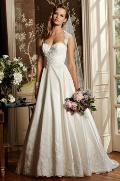 WToo Anastasia elaborately beaded, this silk taffeta and lace full A-line gown…