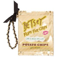 Treat yourself to this trendy wristlet from Betsey Johnson, a clever carryall shaped like a bag of chips and finished with a charming bow. Gold.