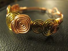 Wire wrapped copper bracelet mixed metal copper by Naomirabinowitz, $20.00