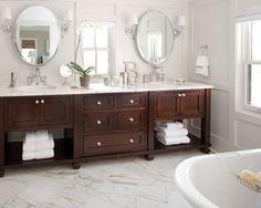 medium dark bathroom vanity (double) with carrera marble top