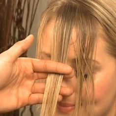 Video: How to Cut and Style Your Bangs at Home....