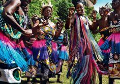 Dancing With the Stars - Lupita celebrates with her fellow Luo women in western Kenya. Roberto Cavalli dress. Cara Croninger earrings. Roxanne Assoulin bracelets.  Photographed at Kit Mikayi, Kisumu County Fashion Editor: Tonne Goodman