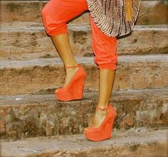 Orange wedges w ankle strap.