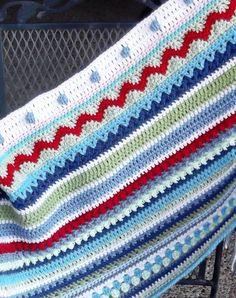 Crochet Crochet Sampler blanket in-progress.  Pattern available.