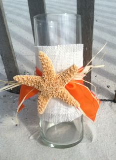 Starfish Centerpiece Vase @McKeela of course blue instead of orange, add some sand to the bottom and a votive...  tabletop centerpiece?