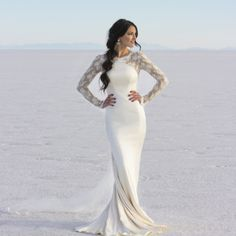 modest wedding dress long lace sleeves and a close to the body fit