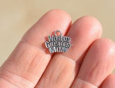 15 Tibetan Silver WORLDS GREATEST MOM Charms