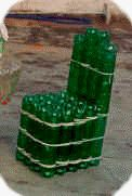 PET bottle chair, wonder how it would go covered in cement or hypertuffa. Plastic Bottle House, Plastic Bottle Crafts, Pet Bottle, Recycle Plastic Bottles, Wine Bottle Crafts, Bottle Art, Recycled Glass Bottles, Plastic Design, Diy Chair