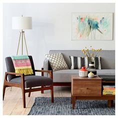 Freshen up with pops of color, vivid prints and textural accents in the Mid Century Colorful Living Room Collection. Add personality to living room furniture with throws, pillows and an area rug. Complete the look with a chic trio of vases.