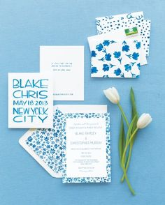 The bride painted the blue-and-white floral pattern on a piece of paper, scanned it, added text, and printed the invitations herself. Get more ideas from this crafty bride by following the link!
