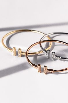 Tiffany T wire bracelets in 18k yellow, rose and white gold with diamonds.