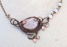 Rhodochrosite wire wrapped pendant by IanirasArtifacts on DeviantArt