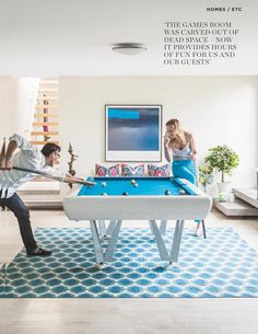 Amazing pool table love the white base and meditteranean blue colored felt!