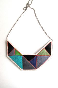 Geometric statement necklace hand embroidered with black, gray, purple, and green colors outlined in red Fall fashion textile jewelry by AnAstridEndeavor on Etsy