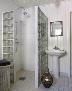 Most Popular Small Bathroom Remodel Ideas on a Budget in 2018 This beautiful look was created with cool colors, and a change of layout. Bad Inspiration, Bathroom Inspiration, Bathroom Renos, Small Bathroom, Striped Accent Walls, Glass Block Shower, Toilet Room, House Design, Home