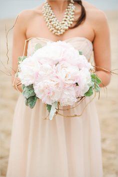 Light pink beachy bouquet. Floral Design: Ashland Addison Florist Co. ---> http://www.weddingchicks.com/2014/05/19/the-perfect-beach-wedding-in-chicago/