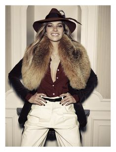 Jessica Hart by Santiago Esteban in Gucci for Elle Spain August 2011