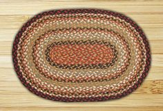 Oval Braided Rug In Burgundy/Mustard/Ivory This rug is made from eco-friendly 100% jute fibers by Earth Rugs. Earth Rugs hallmark has always been working with strong, luxurious jute fiber to create innovative, stylish and durable rugs. Available In Assorted Sizes