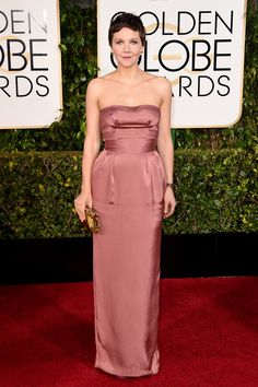 That dusty-rose hue is a tough one to wear without seeming like a lost bridesmaid, but the strapless Miu Miu works on Maggie Gyllenhaal.
