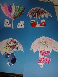 Sateenvarjot värittäen. Kumisaappaisiin liimattiin koristeet.. pikainen sadepäivän työ. Tekijöinä: 5v, 2v8kk ja 2x 3.5v