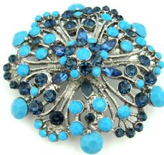 "Big Sapphire Blue Crystal & Turquoise 2.50"" Flower Floral Pendant Brooch Pin . $24.95. Sapphire blue crystals & turquoise set in antiqued silver finish. Flower shaped brooch which can be worn as a pendant or brooch. Gift boxed in white swirl chipboard base box with clear plastic lid"